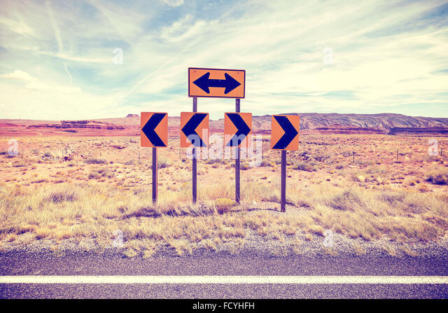 Vintage stylized photo of road signs, choice concept. - Stock Image