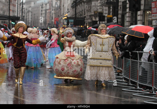 London, UK. 1st January 2017. Performers on Piccadily carry on despite the rain on Piccadilly at the  New Year's - Stock Image
