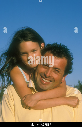 9 year old girl hugging  her 43 year old father - Stock Image