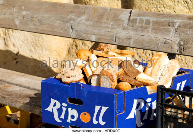 Bread Food Waste on the street - Stock Image