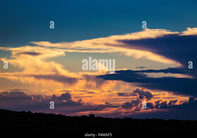 Sunset and clouds over the open landscape, Okonjima, Nambia, Africa - Stock Image
