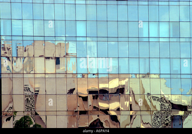 Reflection of building on modern glass building in Bangalore city Karnataka India - Stock-Bilder