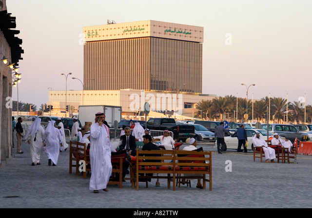 Qatar Doha Qatrar National Bank QNB market place people - Stock Image