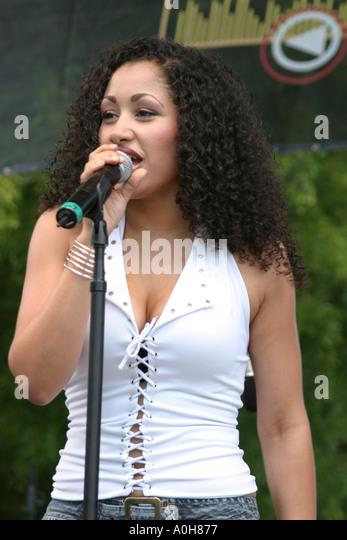 Coconut Grove Florida Grand Avenue Bahamas Goombay Festival Black singer entertainer microphone - Stock Image