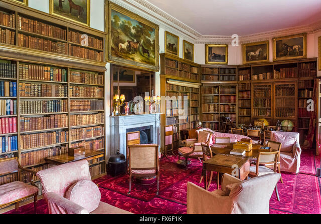 Library at Calke Abbey, an early 18thC baroque mansion near Ticknall, Derbyshire, England, UK - Stock Image