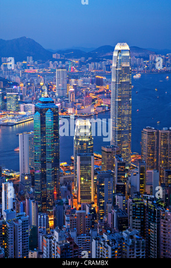 Some of Hong Kong's tallest buildings, including IFC2, seen from The Peak of Hong Kong Island at twilight. - Stock Image