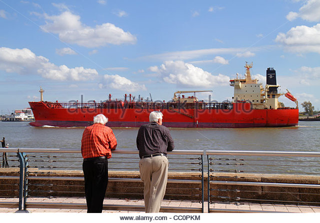 New Orleans Louisiana Spanish Plaza Mississippi River cargo ship vessel hull navigation commercial shipping water - Stock Image