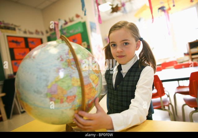 Canada, Québec, Montreal, private school, girl with globe - Stock Image
