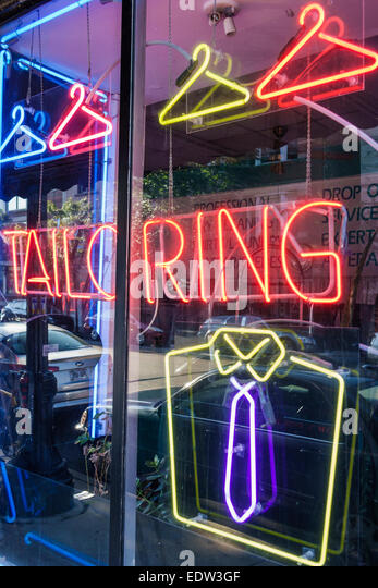 Chicago Illinois Little Italy tailor business window neon sign shirt tie - Stock Image