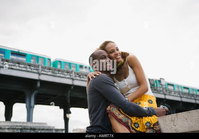 African couple hugging - Stock-Bilder