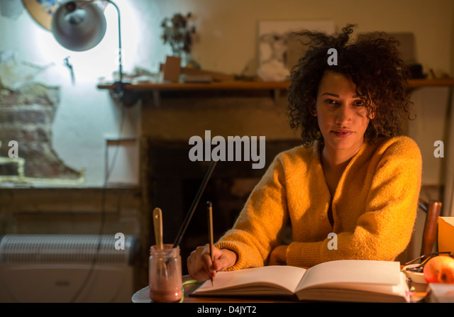 Artist drawing in sketchbook - Stock Image