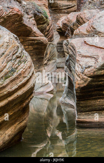 Still Water in Echo Canyon reflects sandstone canyon walls - Stock Image