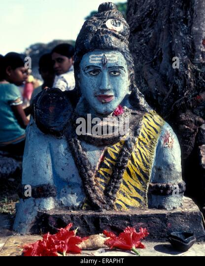 A statue of Lord Krishna on a roadside in Goa - Stock Image