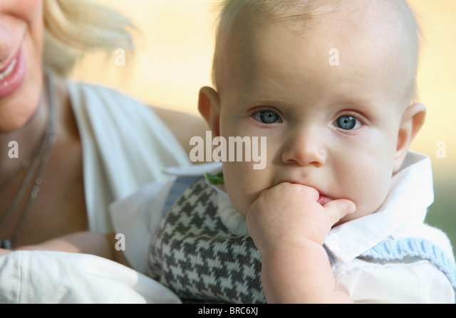 A Mother Holding Her Son; Gresham, Oregon, United States Of America - Stock Image