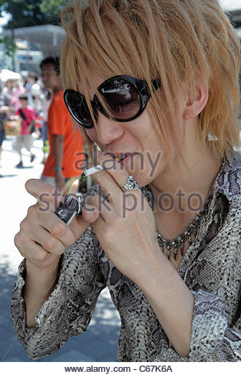 Tokyo Japan Harajuku Takeshita Dori Street shopping shoppers Asian teen boy fashion fashionable blonde hair dyed - Stock Image