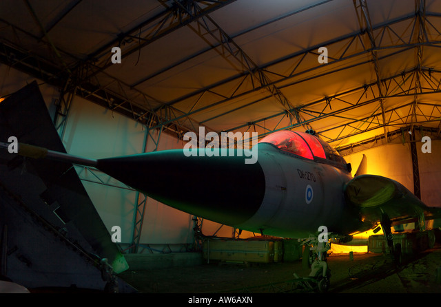 Permanently grounded fighter plane in hangar - Stock Image