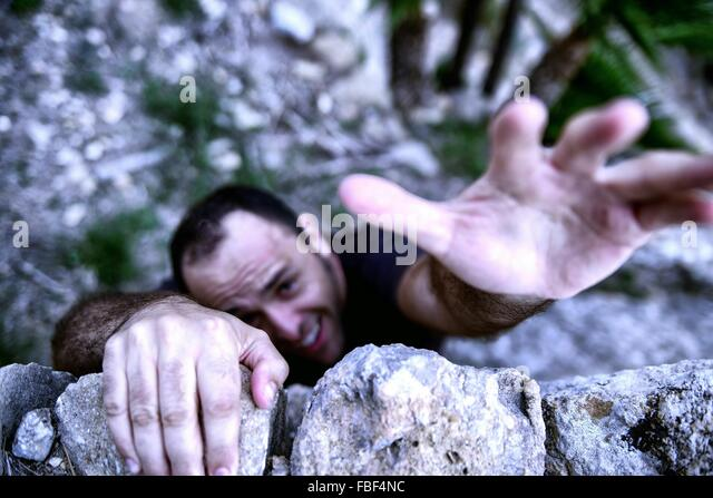 High Angle View Of Man Climbing Wall - Stock Image