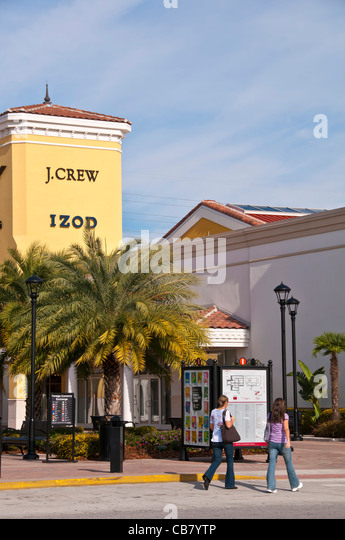 Premium Outlet shopping mall with tourists on International Drive, Orlando Florida - Stock Image