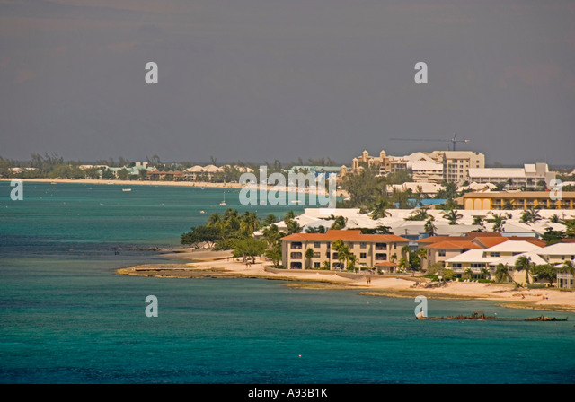 aerial George Town Grand Cayman  condos beach caribbean green water scenic landscape shoreline - Stock Image
