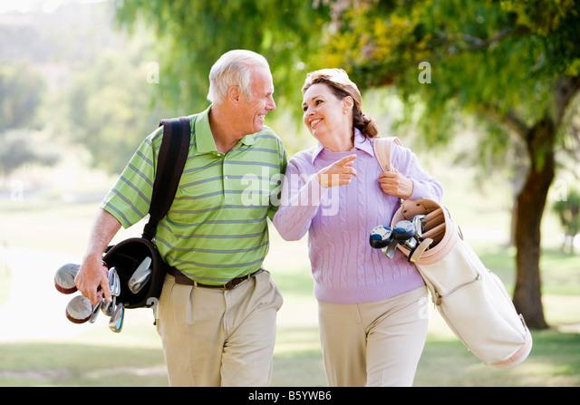 Couple Enjoying A Game Of Golf - Stock Image