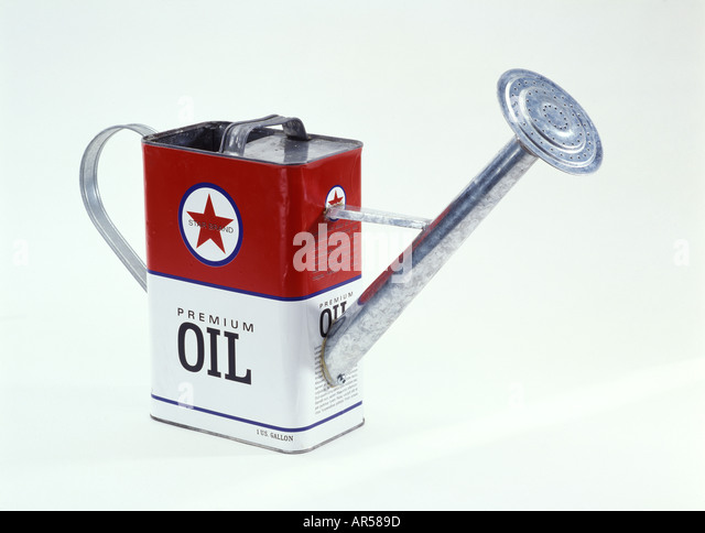 An oil can converted into a watering pale. - Stock-Bilder