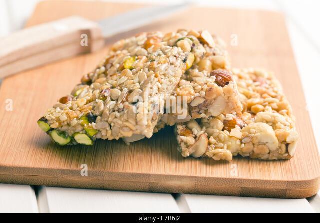 tasty nut bar on table - Stock Image