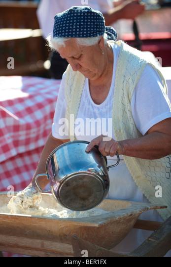 Gyor Food Festival women baking pogácsa - Stock Image