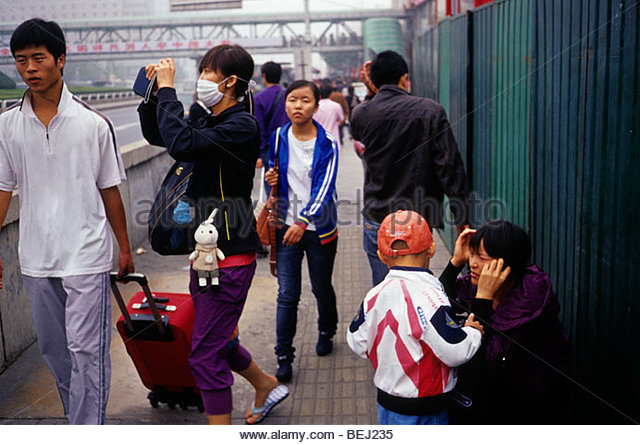 A young lady wears mask to protect against severe pollution in Beijing, China. 30-Sep-2009 - Stock Image