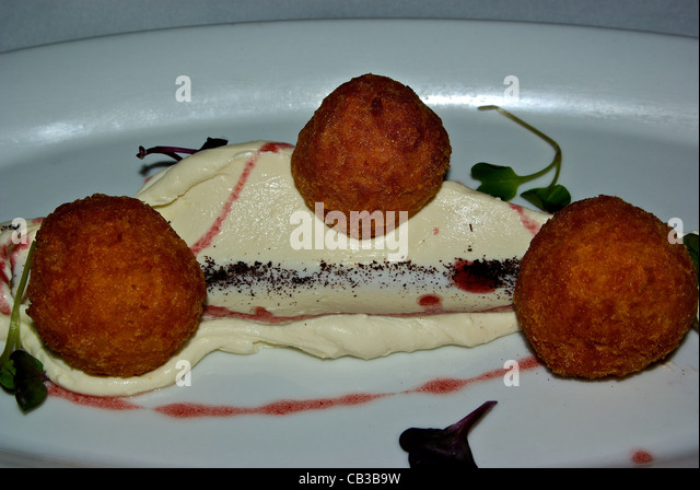 Whipped Fiddlers Hill goat cheese Arancini sumac beetroot oil dressing entree - Stock Image