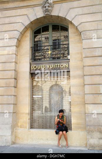 Paris France Europe French 1st arrondissement Place Vendôme Louis Vuitton designer fashion shopping Asian woman - Stock Image
