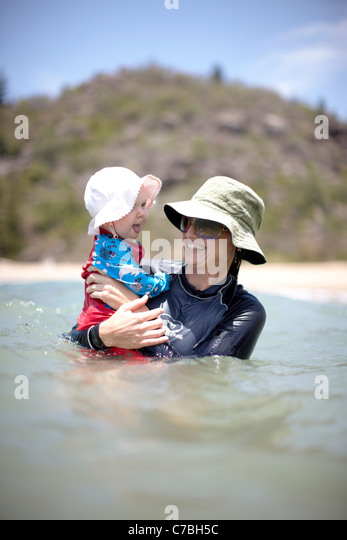 Mother and child bathing at Radical Bay northeast coast of Magnetic island Great Barrier Reef Marine Park UNESCO - Stock-Bilder