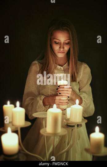 Young woman with candle in hand . Gothic and surreal concept - Stock-Bilder