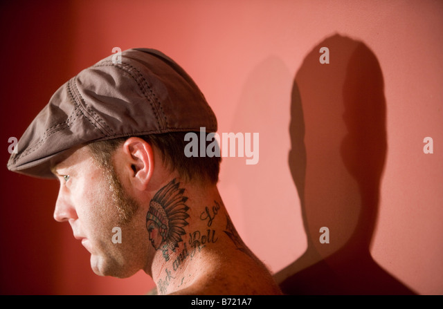 Headshot of young man with tattoo design on neck - Stock-Bilder