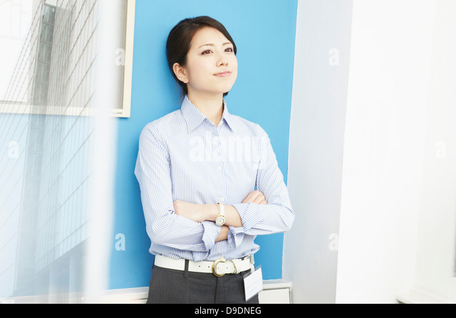 Portrait of woman with arms folded - Stock Image