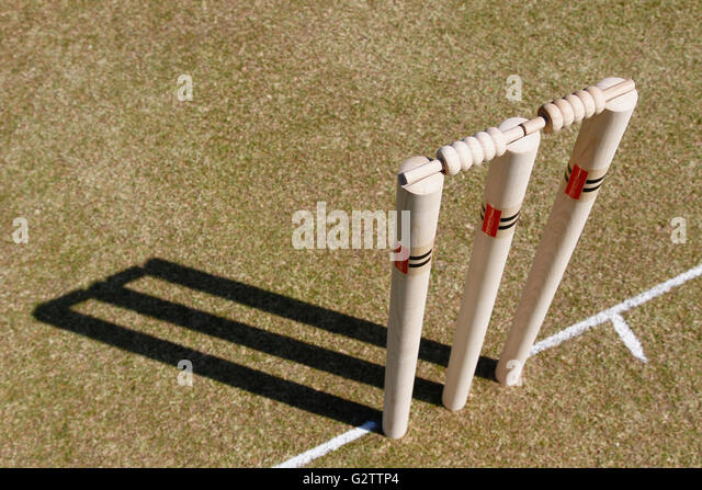Sport, Ball, Cricket, Wooden Stumps. - Stock Image