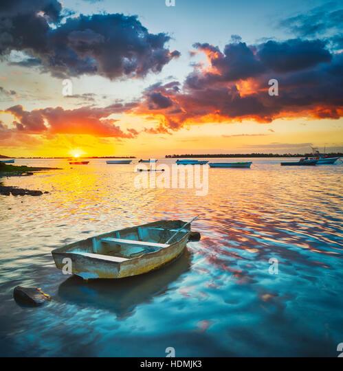 Fishing boat at sunset time.  Mauritius. - Stock Image