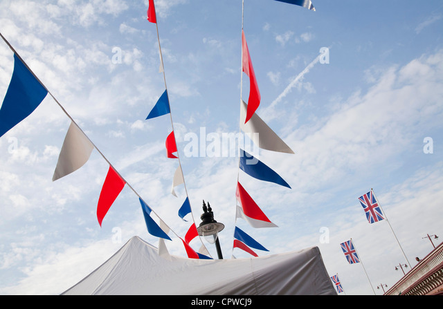 London jubilee bunting, flags and South Bank riverside street lamp and Blackfriars bridge. - Stock Image