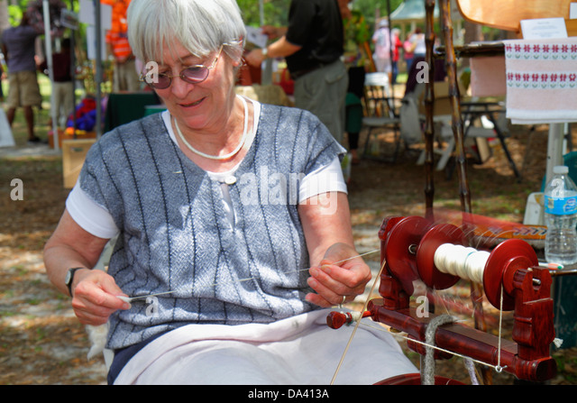 Georgia Thomasville Paradise Park Rose Show & Festival weekend Arts in the Park crafts flea market senior woman - Stock Image