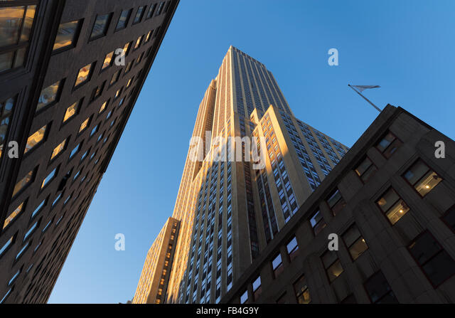 Empire State Building at sunset from below. Low angle view of the Art Deco skyscraper located in Midtown Manhattan, - Stock Image