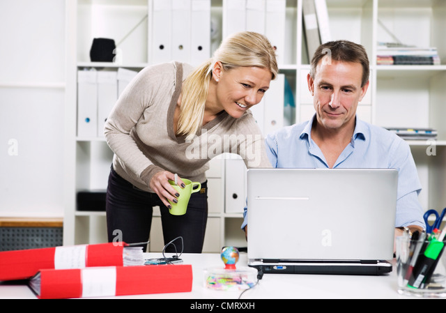 Woman and man on the office - Stock Image