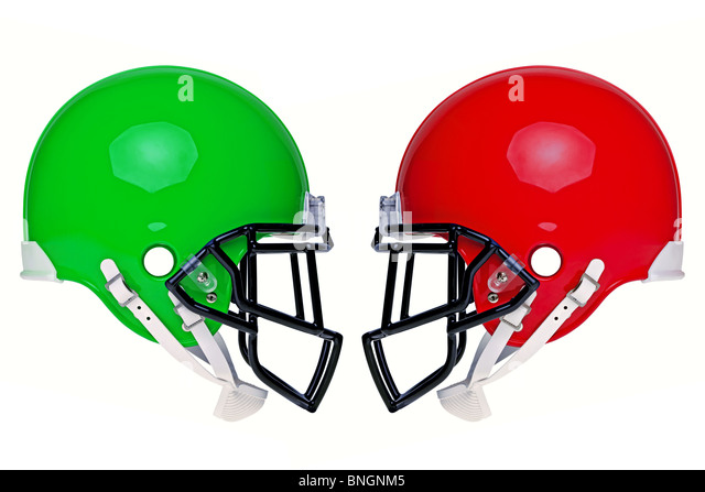 Photo of two American football helmets isolated on a white background. - Stock Image