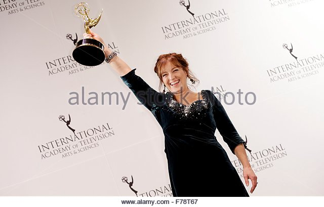 epa05039278 Actress Anneke von der Lippe, of Norway, poses with the International Emmy award in the 'Best Performance - Stock Image
