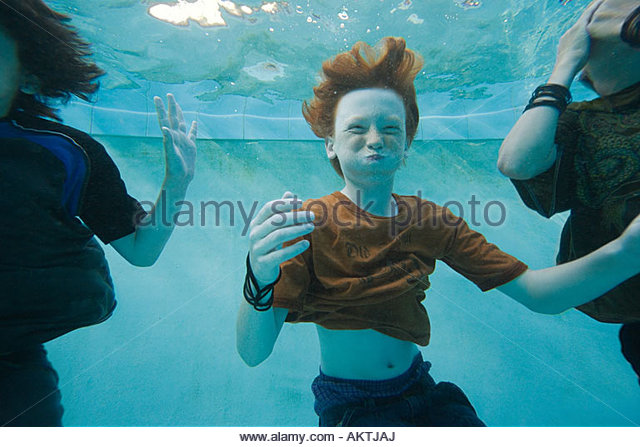 Boys swimming underwater - Stock-Bilder