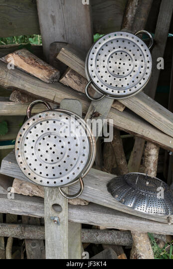 Set of kitchen steaming equipment drying out in a woodshed.+ - Stock Image