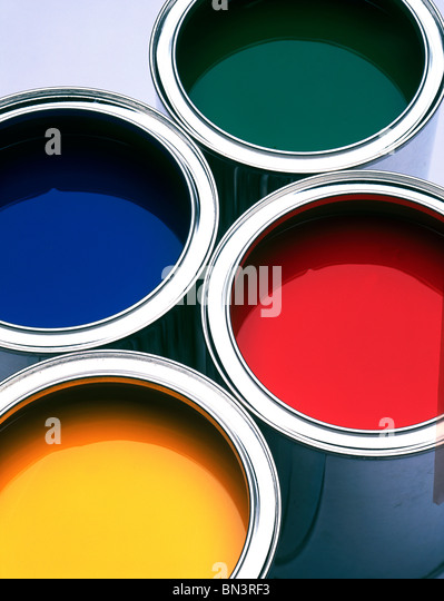 Close-up of four paint cans - Stock Image