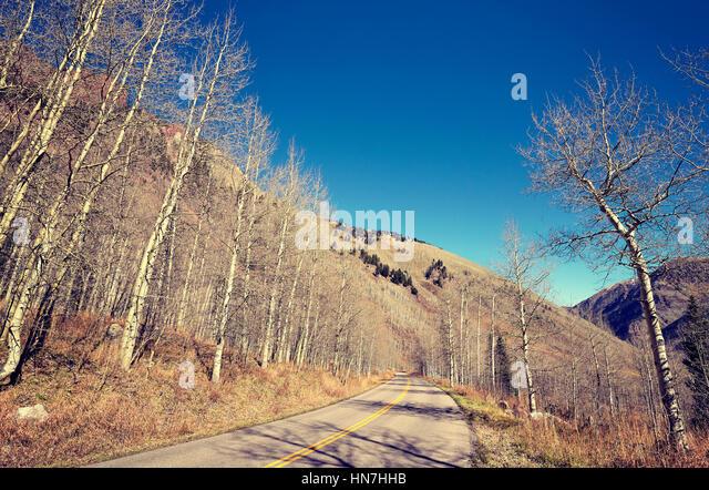 Retro stylized mountain road, travel concept, USA. - Stock-Bilder