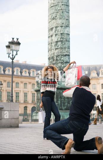 Tourist with shopping bags, Paris, France - Stock-Bilder