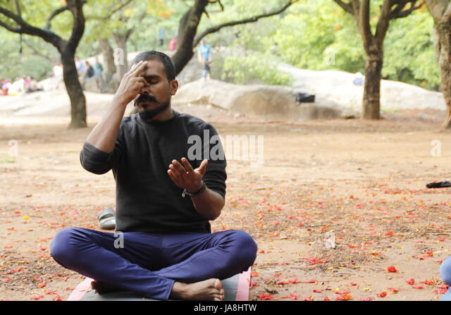 Young Indian male doing yoga - Stock Image