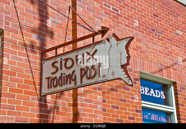 Sioux Trading Post sign on outside of brick souvenir building in Rapid City - Stock Image