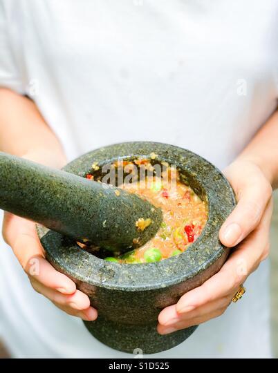 Namprik - Thai chili shrimp paste in stone mortar - Stock-Bilder